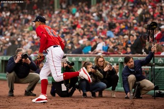 BOSTON, MA - MAY 15: Mookie Betts #50 of the Boston Red Sox runs onto the field before a game against the Colorado Rockies on May 15, 2019 at Fenway Park in Boston, Massachusetts. (Photo by Billie Weiss/Boston Red Sox/Getty Images) *** Local Caption *** Mookie Betts