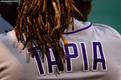 BOSTON, MA - MAY 15: Raimel Tapia #15 of the Colorado Rockies looks on during the first inning of a game against the Boston Red Sox on May 15, 2019 at Fenway Park in Boston, Massachusetts. (Photo by Billie Weiss/Boston Red Sox/Getty Images) *** Local Caption *** Raimel Tapia
