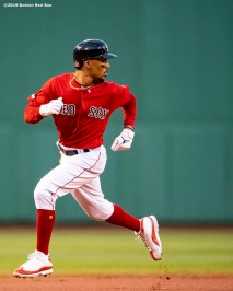 BOSTON, MA - MAY 15: Mookie Betts #50 of the Boston Red Sox advances to third base during the first inning of a game against the Colorado Rockies on May 15, 2019 at Fenway Park in Boston, Massachusetts. (Photo by Billie Weiss/Boston Red Sox/Getty Images) *** Local Caption *** Mookie Betts