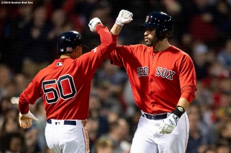 BOSTON, MA - MAY 15: J.D. Martinez #28 of the Boston Red Sox reacts with Mookie Betts #50 after hitting a two run home run during the third inning of a game against the Colorado Rockies on May 15, 2019 at Fenway Park in Boston, Massachusetts. (Photo by Billie Weiss/Boston Red Sox/Getty Images) *** Local Caption *** J.D. Martinez; Mookie Betts