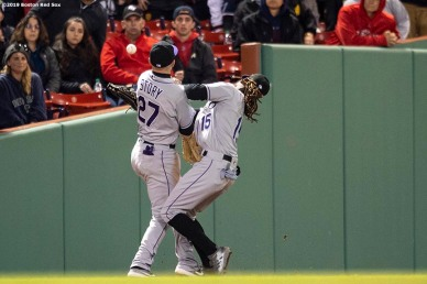 BOSTON, MA - MAY 15: Trevor Story #27 collides with Raimel Tapia #15 of the Colorado Rockies as they attempt to catch a fly ball hit by Mookie Betts #50 of the Boston Red Sox during the ninth inning of a game on May 15, 2019 at Fenway Park in Boston, Massachusetts. (Photo by Billie Weiss/Boston Red Sox/Getty Images) *** Local Caption *** Trevor Story; Raimel Tapia