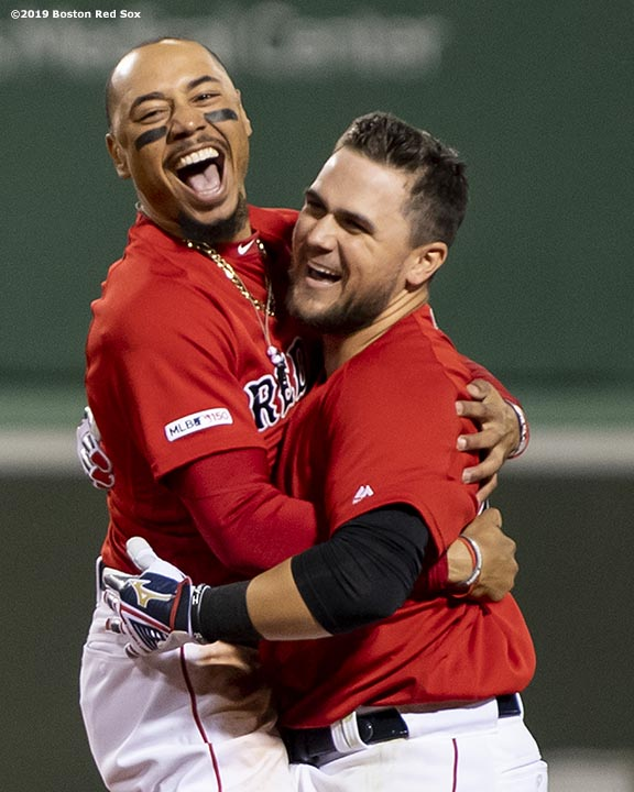 BOSTON, MA - MAY 15: Michael Chavis #23 of the Boston Red Sox reacts with Mookie Betts #50 after hitting a game winning walk-off RBI single during the tenth inning of a game against the Colorado Rockies on May 15, 2019 at Fenway Park in Boston, Massachusetts. (Photo by Billie Weiss/Boston Red Sox/Getty Images) *** Local Caption *** Michael Chavis; Mookie Betts