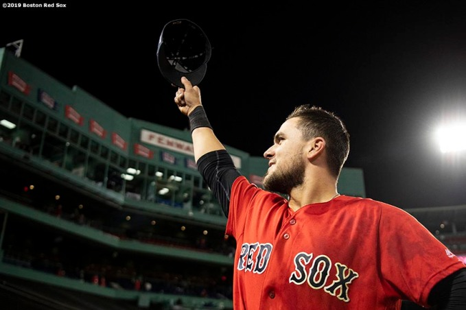 BOSTON, MA - MAY 15: Michael Chavis #23 of the Boston Red Sox tips his cap to the crowd after hitting a game winning walk-off RBI single during the tenth inning of a game against the Colorado Rockies on May 15, 2019 at Fenway Park in Boston, Massachusetts. (Photo by Billie Weiss/Boston Red Sox/Getty Images) *** Local Caption *** Michael Chavis