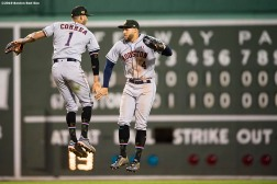 BOSTON, MA - MAY 18: George Springer #4 and Carlos Correa #1 of the Houston Astros celebrate a victory against the Boston Red Sox on May 18, 2019 at Fenway Park in Boston, Massachusetts. (Photo by Billie Weiss/Boston Red Sox/Getty Images) *** Local Caption *** George Springer; Carlos Correa
