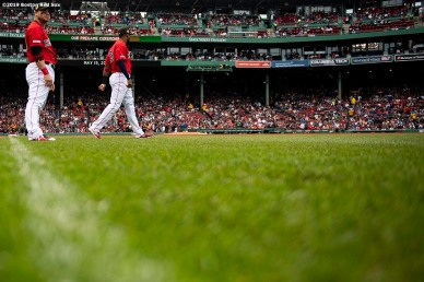 BOSTON, MA - MAY 19: Steve Pearce #25 and Eduardo Nunez #36 of the Boston Red Sox warm up before a game against the Houston Astros on May 19, 2019 at Fenway Park in Boston, Massachusetts. (Photo by Billie Weiss/Boston Red Sox/Getty Images) *** Local Caption *** Steve Pearce; Eduardo Nunez