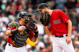 BOSTON, MA - MAY 19: Christian Vazquez #7 of the Boston Red Sox talks with Chris Sale #41 during the second inning of a game against the Houston Astros on May 19, 2019 at Fenway Park in Boston, Massachusetts. (Photo by Billie Weiss/Boston Red Sox/Getty Images) *** Local Caption *** Christian Vazquez; Chris Sale