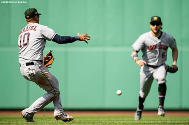 BOSTON, MA - MAY 19: Yuli Gurriel #10 and Jake Marisnick #6 of the Houston Astros miscommunicate on a fly ball as it drops to allow the game tying run during the fifth inning of a game against the Boston Red Sox on May 19, 2019 at Fenway Park in Boston, Massachusetts. (Photo by Billie Weiss/Boston Red Sox/Getty Images) *** Local Caption *** Yuli Gurriel; Jake Marisnick