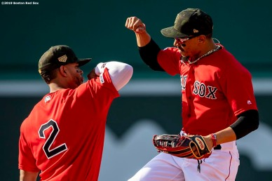 BOSTON, MA - MAY 19: Xander Bogaerts #2 and Mookie Betts #50 of the Boston Red Sox celebrate a victory against the Houston Astros on May 19, 2019 at Fenway Park in Boston, Massachusetts. (Photo by Billie Weiss/Boston Red Sox/Getty Images) *** Local Caption *** Mookie Betts; Xander Bogaerts