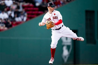 BOSTON, MA - MAY 27: Brock Holt #12 of the Boston Red Sox leaps as he throws during the first inning of a game against the Cleveland Indians on May 27, 2019 at Fenway Park in Boston, Massachusetts. (Photo by Billie Weiss/Boston Red Sox/Getty Images) *** Local Caption *** Brock Holt