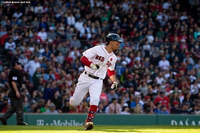 BOSTON, MA - MAY 27: Mookie Betts #50 of the Boston Red Sox rounds first base as he hits a single during the fifth inning of a game against the Cleveland Indians on May 27, 2019 at Fenway Park in Boston, Massachusetts. (Photo by Billie Weiss/Boston Red Sox/Getty Images) *** Local Caption *** Mookie Betts