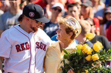 BOSTON, MA - MAY 27: Christian Vazquez #7 of the Boston Red Sox greets a gold star family member during a pre game ceremony before a game between the Boston Red Sox and the Cleveland Indians on May 27, 2019 at Fenway Park in Boston, Massachusetts. (Photo by Billie Weiss/Boston Red Sox/Getty Images) *** Local Caption *** Christian Vazquez