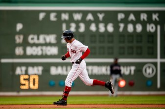 BOSTON, MA - MAY 29: Mookie Betts #50 of the Boston Red Sox rounds the bases after hitting a solo home run during the first inning of a game against the Cleveland Indians on May 29, 2019 at Fenway Park in Boston, Massachusetts. (Photo by Billie Weiss/Boston Red Sox/Getty Images) *** Local Caption *** Mookie Betts