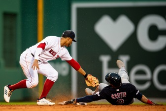 BOSTON, MA - MAY 29: Xander Bogaerts #2 of the Boston Red Sox tags out Leonys Martin #2 of the Cleveland Indians as he attempts to steal second base during the fourth inning of a game on May 29, 2019 at Fenway Park in Boston, Massachusetts. (Photo by Billie Weiss/Boston Red Sox/Getty Images) *** Local Caption *** Xander Bogaerts; Leonys Martin