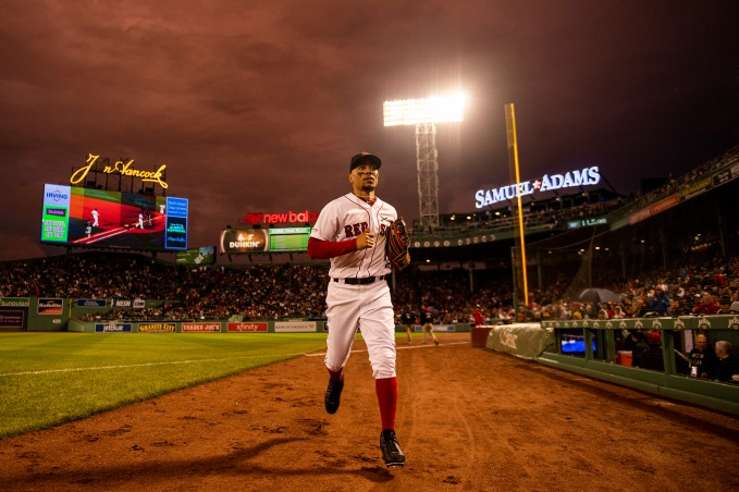 BOSTON, MA - MAY 29: Mookie Betts #50 of the Boston Red Sox runs off the field as the sun sets during the sixth inning of a game against the Cleveland Indians on May 29, 2019 at Fenway Park in Boston, Massachusetts. (Photo by Billie Weiss/Boston Red Sox/Getty Images) *** Local Caption *** Mookie Betts