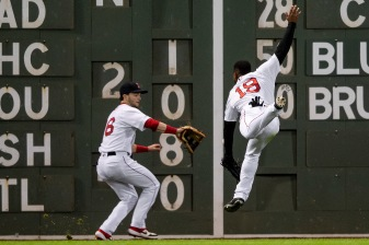 BOSTON, MA - MAY 29: Jackie Bradley Jr. #19 and Andrew Benintendi #16 of the Boston Red Sox chase a base hit during the seventh inning of a game against the Cleveland Indians on May 29, 2019 at Fenway Park in Boston, Massachusetts. (Photo by Billie Weiss/Boston Red Sox/Getty Images) *** Local Caption *** Jackie Bradley Jr.; Andrew Benintendi