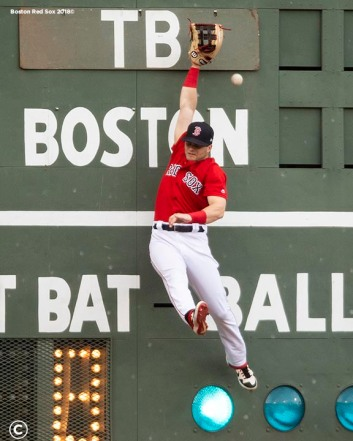BOSTON, MA - JUNE 7: Andrew Benintendi #16 of the Boston Red Sox attempts to catch a fly ball in front of the Green Monster scoreboard during the first inning of a game against the Tampa Bay Rays on June 7, 2019 at Fenway Park in Boston, Massachusetts. (Photo by Billie Weiss/Boston Red Sox/Getty Images) *** Local Caption *** Andrew Benintendi