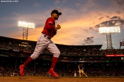 BOSTON, MA - JUNE 7: Mookie Betts #50 of the Boston Red Sox runs onto the field during the sixth inning of a game against the Tampa Bay Rays on June 7, 2019 at Fenway Park in Boston, Massachusetts. (Photo by Billie Weiss/Boston Red Sox/Getty Images) *** Local Caption *** Mookie Betts