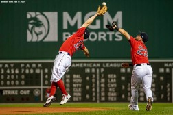 BOSTON, MA - JUNE 7: Brock Holt #12 collides with Michael Chavis #23 of the Boston Red Sox as he catches a fly ball during the eighth inning of a game against the Tampa Bay Rays on June 7, 2019 at Fenway Park in Boston, Massachusetts. (Photo by Billie Weiss/Boston Red Sox/Getty Images) *** Local Caption *** Brock Holt; Michael Chavis