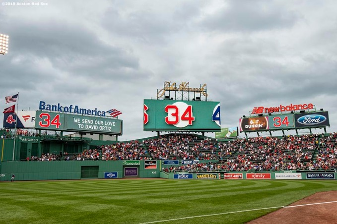 BOSTON, MA - JUNE 10: A moment of reflection is held as a message is displayed on the scoreboard for former designated hitter David Ortiz of the Boston Red Sox after he was shot in the Dominican Republic before a game against the Texas Rangers on June 10, 2019 at Fenway Park in Boston, Massachusetts. (Photo by Billie Weiss/Boston Red Sox/Getty Images) *** Local Caption *** David Ortiz