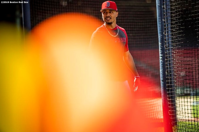 BOSTON, MA - JUNE 11: Mookie Betts #50 of the Boston Red Sox looks on before a game between the Boston Red Sox and the Texas Rangers on June 11, 2019 at Fenway Park in Boston, Massachusetts. (Photo by Billie Weiss/Boston Red Sox/Getty Images) *** Local Caption *** Mookie Betts
