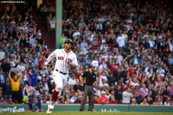BOSTON, MA - JUNE 11: Xander Bogaerts #2 of the Boston Red Sox rounds first base after hitting a solo home run during the first inning of a game against the Texas Rangers on June 11, 2019 at Fenway Park in Boston, Massachusetts. (Photo by Billie Weiss/Boston Red Sox/Getty Images) *** Local Caption *** Xander Bogaerts