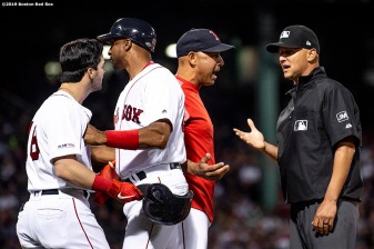 BOSTON, MA - JUNE 11: Manager Alex Cora of the Boston Red Sox argues with first base umpire Vic Carapazza as first base coach Tom Goodwin holds back Andrew Benintendi #16 after Benintendi was ejected during the sixth inning of a game against the Texas Rangers on June 11, 2019 at Fenway Park in Boston, Massachusetts. (Photo by Billie Weiss/Boston Red Sox/Getty Images) *** Local Caption *** Alex Cora; Tom Goodwin; Vic Carapazza; Andrew Benintendi