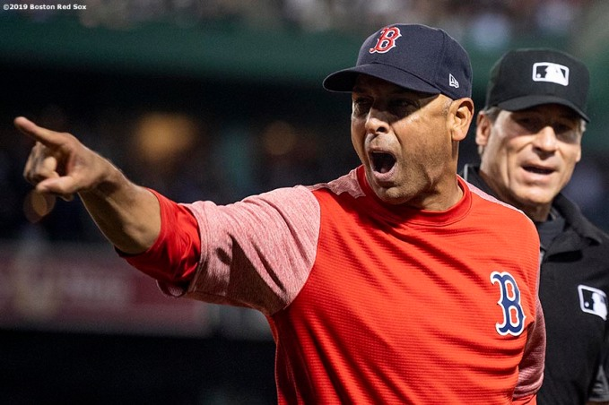 BOSTON, MA - JUNE 11: Manager Alex Cora of the Boston Red Sox argues after being ejected by first base umpire Vic Carapazza as home plate umpire Angel Hernandez looks on during the sixth inning of a game against the Texas Rangers on June 11, 2019 at Fenway Park in Boston, Massachusetts. (Photo by Billie Weiss/Boston Red Sox/Getty Images) *** Local Caption *** Alex Cora; Vic Carapazza; Angel Hernandez