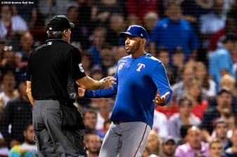 BOSTON, MA - JUNE 11: Manager Chris Woodward of the Texas Rangers argues as he is ejected by home plate umpire Angel Hernandez during the sixth inning of a game against the Boston Red Sox on June 11, 2019 at Fenway Park in Boston, Massachusetts. (Photo by Billie Weiss/Boston Red Sox/Getty Images) *** Local Caption *** Chris Woodward; Angel Hernandez