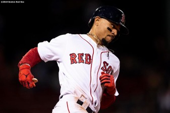 BOSTON, MA - JUNE 11: Mookie Betts #50 of the Boston Red Sox rounds the bases after hitting a solo home run during the ninth inning of a game against the Texas Rangers on June 11, 2019 at Fenway Park in Boston, Massachusetts. (Photo by Billie Weiss/Boston Red Sox/Getty Images) *** Local Caption *** Mookie Betts