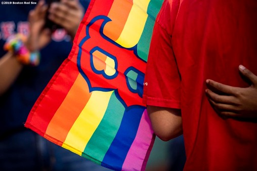 BOSTON, MA - JUNE 11: The Boston Red Sox rainbow logo is displayed on a flag in recognition of Pride night before a game against the Texas Rangers on June 11, 2019 at Fenway Park in Boston, Massachusetts. (Photo by Billie Weiss/Boston Red Sox/Getty Images) *** Local Caption ***