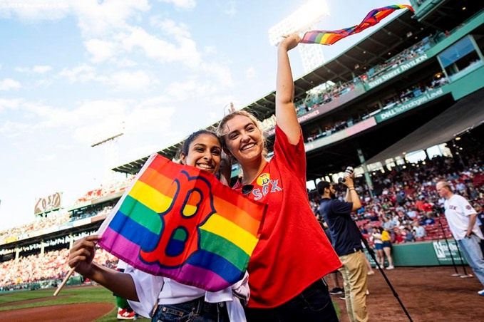 BOSTON, MA - JUNE 11: Fans display Boston Red Sox rainbow flags in recognition of Pride night before a game against the Texas Rangers on June 11, 2019 at Fenway Park in Boston, Massachusetts. (Photo by Billie Weiss/Boston Red Sox/Getty Images) *** Local Caption ***