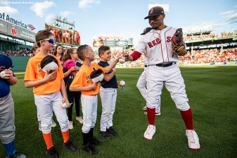 BOSTON, MA - JUNE 11: Mookie Betts #50 of the Boston Red Sox greets little leaguers as they take the field before a game against the Texas Rangers on June 11, 2019 at Fenway Park in Boston, Massachusetts. (Photo by Billie Weiss/Boston Red Sox/Getty Images) *** Local Caption *** Mookie Betts