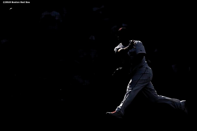 BOSTON, MA - JUNE 12: Rafael Devers #11 of the Boston Red Sox throws during the second inning of a game against the Texas Rangers on June 12, 2019 at Fenway Park in Boston, Massachusetts. (Photo by Billie Weiss/Boston Red Sox/Getty Images) *** Local Caption *** Rafael Devers