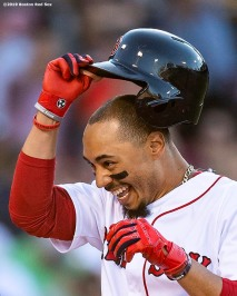 BOSTON, MA - JUNE 12: Mookie Betts #50 of the Boston Red Sox reacts after being walked to force in the game winning run on a walk off during the ninth inning of a game against the Texas Rangers on June 12, 2019 at Fenway Park in Boston, Massachusetts. (Photo by Billie Weiss/Boston Red Sox/Getty Images) *** Local Caption *** Mookie Betts