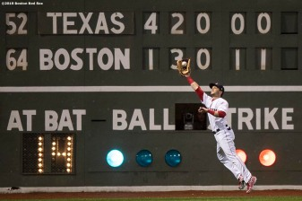 BOSTON, MA - JUNE 13: Andrew Benintendi #16 of the Boston Red Sox catches a fly ball during the sixth inning of a game against the Texas Rangers on June 13, 2019 at Fenway Park in Boston, Massachusetts. (Photo by Billie Weiss/Boston Red Sox/Getty Images) *** Local Caption *** Andrew Benintendi