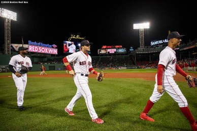 BOSTON, MA - JUNE 13: Jackie Bradley Jr. #19, Andrew Benintendi #16, and Mookie Betts #50 of the Boston Red Sox celebrate a victory against the Texas Rangers on June 13, 2019 at Fenway Park in Boston, Massachusetts. (Photo by Billie Weiss/Boston Red Sox/Getty Images) *** Local Caption *** Jackie Bradley Jr.; Andrew Benintendi; Mookie Betts