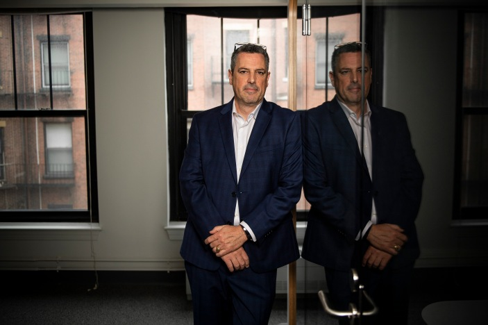"""Members of Elevate Communications pose for portraits at their office in Boston, Massachusetts."""