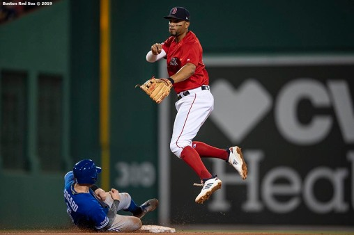 BOSTON, MA - JUNE 21: Xander Bogaerts #2 of the Boston Red Sox turns a double play over Eric Sogard #5 of the Toronto Blue Jays during the sixth inning of a game on June 21, 2019 at Fenway Park in Boston, Massachusetts. (Photo by Billie Weiss/Boston Red Sox/Getty Images) *** Local Caption *** Xander Bogaerts; Eric Sogard