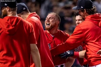 BOSTON, MA - JUNE 21: Christian Vazquez #7 of the Boston Red Sox reacts with teammates after hitting a game winning walk-off two run home run during the tenth inning of a game against the Toronto Blue Jays on June 21, 2019 at Fenway Park in Boston, Massachusetts. (Photo by Billie Weiss/Boston Red Sox/Getty Images) *** Local Caption *** Christian Vazquez