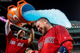 BOSTON, MA - JUNE 21: Christian Vazquez #7 of the Boston Red Sox is doused with Gatorade by Xander Bogaerts #2 after hitting a game winning walk-off two run home run during the tenth inning of a game against the Toronto Blue Jays on June 21, 2019 at Fenway Park in Boston, Massachusetts. (Photo by Billie Weiss/Boston Red Sox/Getty Images) *** Local Caption *** Christian Vazquez; Xander Bogaerts