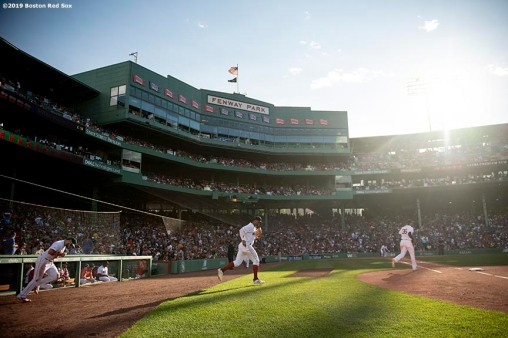 BOSTON, MA - JUNE 22: Members of the Boston Red Sox run onto the field during the sixth inning of a game against the Toronto Blue Jays on June 22, 2019 at Fenway Park in Boston, Massachusetts. (Photo by Billie Weiss/Boston Red Sox/Getty Images) *** Local Caption ***