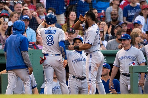 BOSTON, MA - JUNE 22: Cavan Biggio #8 of the Toronto Blue Jays high fives teammates after scoring on a forced in walk thrown by Ryan Brasier #70 of the Boston Red Sox during the eighth inning of a game on June 22, 2019 at Fenway Park in Boston, Massachusetts. (Photo by Billie Weiss/Boston Red Sox/Getty Images) *** Local Caption *** Cavan Biggio
