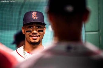 BOSTON, MA - JUNE 24: Mookie Betts #50 of the Boston Red Sox reacts as he looks in the mirror before a game against the Chicago White Sox on June 24, 2019 at Fenway Park in Boston, Massachusetts. (Photo by Billie Weiss/Boston Red Sox/Getty Images) *** Local Caption *** Mookie Betts