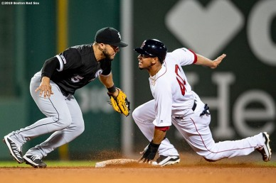 BOSTON, MA - JUNE 24: Marco Hernandez #40 of the Boston Red Sox evades the tag of Yolmer Sanchez #5 of the Chicago White Sox as he steals second base during the eighth inning of a game on June 24, 2019 at Fenway Park in Boston, Massachusetts. (Photo by Billie Weiss/Boston Red Sox/Getty Images) *** Local Caption *** Marco Hernandez; Yolmer Sanchez