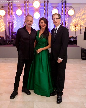 LONDON, ENGLAND - JUNE 27: Musical artist Sting poses for a photograph with Fenway Sports Group Partner Linda Pizzuti Henry and greets Boston Red Sox Principal Owner John Henry during the Mission Gratitude Gala in Cooperation with Home Base and the Red Sox Foundation ahead of the 2019 Major League Baseball London Series on June 27, 2019 at Kensington Palace in London, England. (Photo by Billie Weiss/Boston Red Sox/Getty Images) *** Local Caption *** Sting; Linda Pizzuti Henry; John Henry