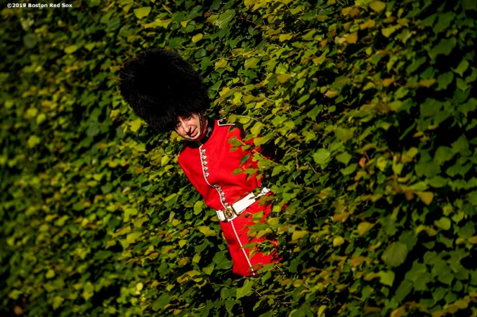 LONDON, ENGLAND - JUNE 27: A guard peeks from behind the hedge during the Mission Gratitude Gala in Cooperation with Home Base and the Red Sox Foundation ahead of the 2019 Major League Baseball London Series on June 27, 2019 at Kensington Palace in London, England. (Photo by Billie Weiss/Boston Red Sox/Getty Images) *** Local Caption ***