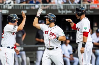 LONDON, ENGLAND - JUNE 29 : Michael Chavis #23 of the Boston Red Sox high fives J.D. Martinez #28 and Brock Holt #12 after hitting a game tying three run home run during the first inning of game one of the 2019 Major League Baseball London Series against the New York Yankees on June 29, 2019 at West Ham London Stadium in London, England. (Photo by Billie Weiss/Boston Red Sox/Getty Images) *** Local Caption *** Michael Chavis; J.D. Martinez; Brock Holt