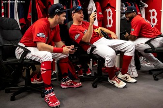 LONDON, ENGLAND - JUNE 30: Andrew Benintendi #16, Brock Holt #12, and Jackie Bradley Jr. #19 of the Boston Red Sox talk in the clubhouse before game two of the 2019 Major League Baseball London Series against the New York Yankees on June 30, 2019 at West Ham London Stadium in London, England. (Photo by Billie Weiss/Boston Red Sox/Getty Images) *** Local Caption *** Andrew Benintendi; Brock Holt; Jackie Bradley Jr.