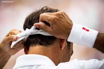 July 2, 2019 , Wimbledon, England: Roger Federer adjusts his hair tie during a match against Lloyd Harris on Centre Court during the 2019 Championships Wimbledon at the All England Lawn Tennis Club in Wimbledon, England Tuesday, July 2, 2019. (Photo by Billie Weiss/Wimbledon)