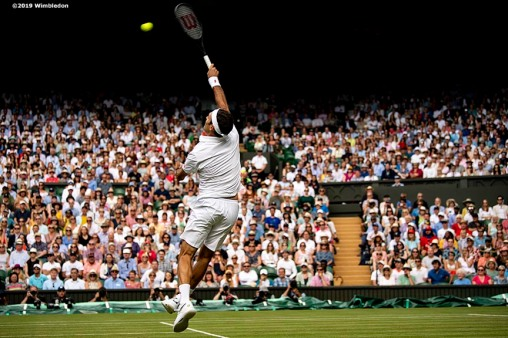 July 2, 2019 , Wimbledon, England: Roger Federer hits a volley during a match against Lloyd Harris on Centre Court during the 2019 Championships Wimbledon at the All England Lawn Tennis Club in Wimbledon, England Tuesday, July 2, 2019. (Photo by Billie Weiss/Wimbledon)